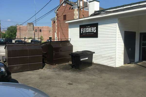 A landlord's plan to move these dumpsters has met with resistance from neighbors and the P&Z.