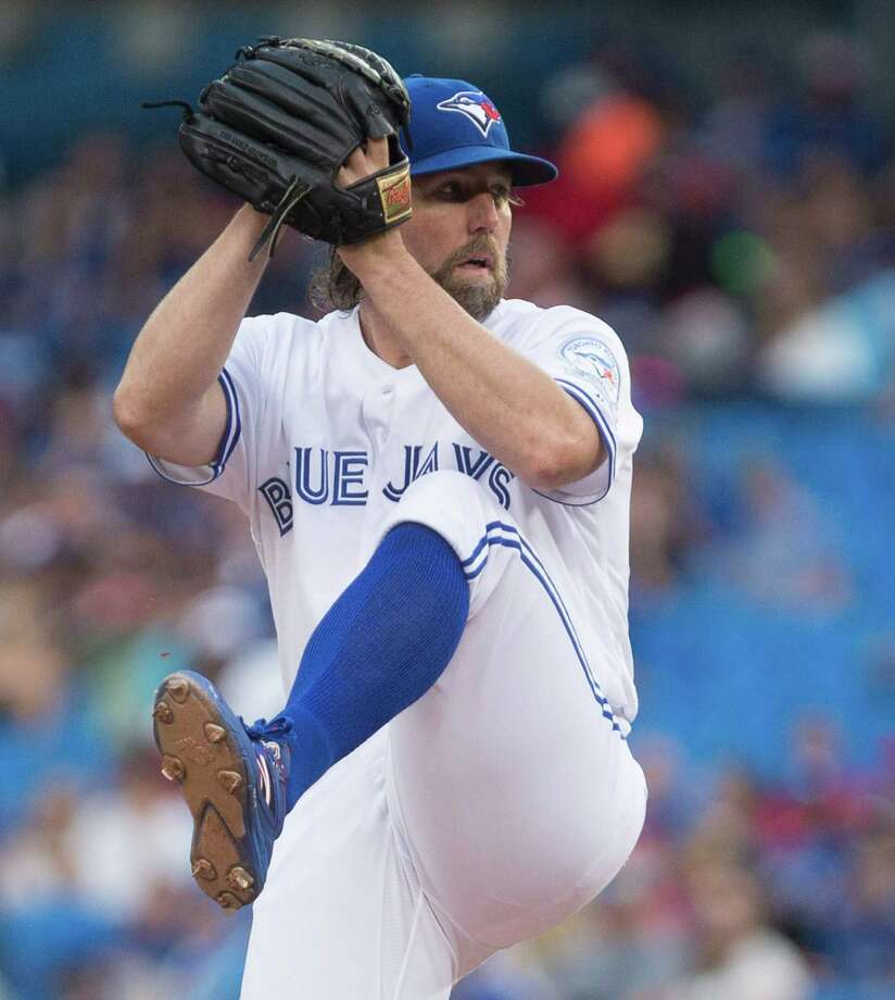 Toronto Blue Jays starting pitcher R.A. Dickey works against the Los Angeles Angels during the first inning of a baseball game Tuesday, Aug. 23, 2016, in Toronto. (Chris Young/The Canadian Press via AP) ORG XMIT: CHY112 Photo: Chris Young / The Canadian Press