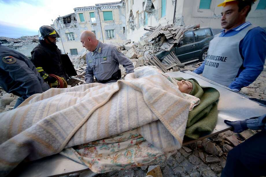 Rescuers carry a man from the rubble after a strong heartquake hit Amatrice on August 24, 2016.  Central Italy was struck by a powerful, 6.2-magnitude earthquake in the early hours, which has killed at least three people and devastated dozens of mountain villages. Numerous buildings had collapsed in communities close to the epicenter of the quake near the town of Norcia in the region of Umbria, witnesses told Italian media, with an increase in the death toll highly likely. / AFP PHOTO / FILIPPO MONTEFORTEFILIPPO MONTEFORTE/AFP/Getty Images Photo: FILIPPO MONTEFORTE, AFP/Getty Images