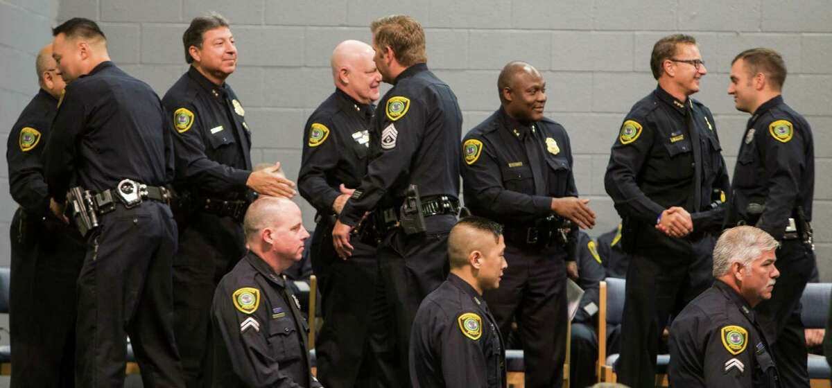 Officers shake hands with senior Houston Police Department staff as they are presented with a Chief of Police Unit Citation during the HPD Award Ceremony at the Houston Police Academy on Tuesday, Aug. 23, 2016, in Houston.