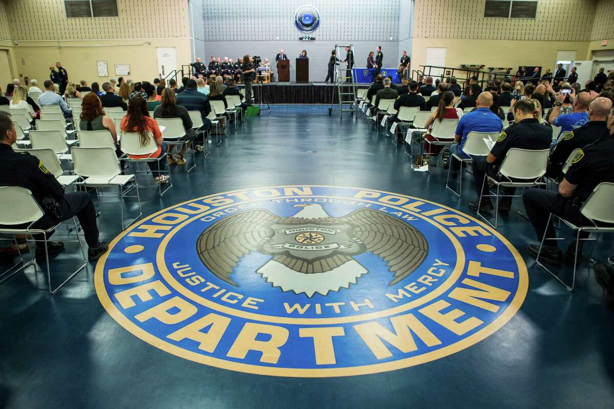 Friends and family of Houston Police officer attend the HPD Award Ceremony at the Houston Police Academy on Tuesday, Aug. 23, 2016, in Houston.