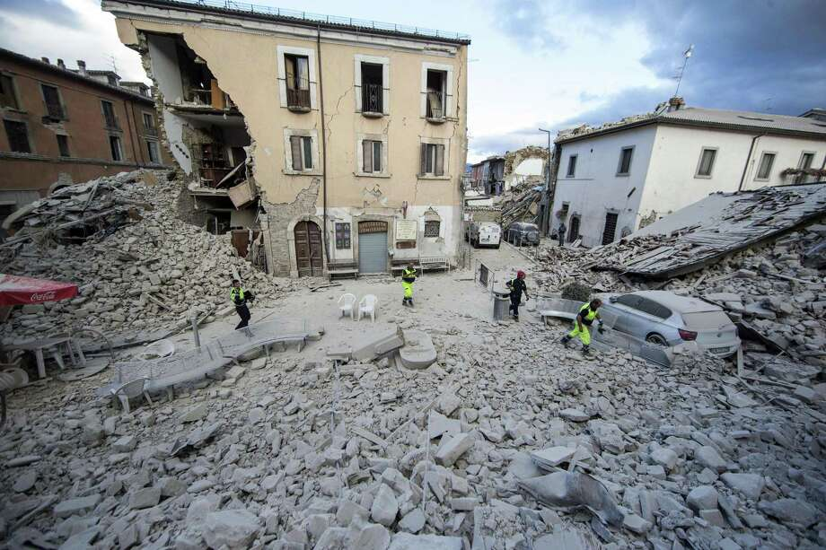 The side of a building is collapsed following an earthquake, in Amatrice Italy, Wednesday, Aug. 24, 2016.  The magnitude 6 quake struck at 3:36 a.m. (0136 GMT) and was felt across a broad swath of central Italy, including Rome where residents of the capital felt a long swaying followed by aftershocks. (Massimo Percossi/ANSA via AP) Photo: Massimo Percossi, AP / ANSA