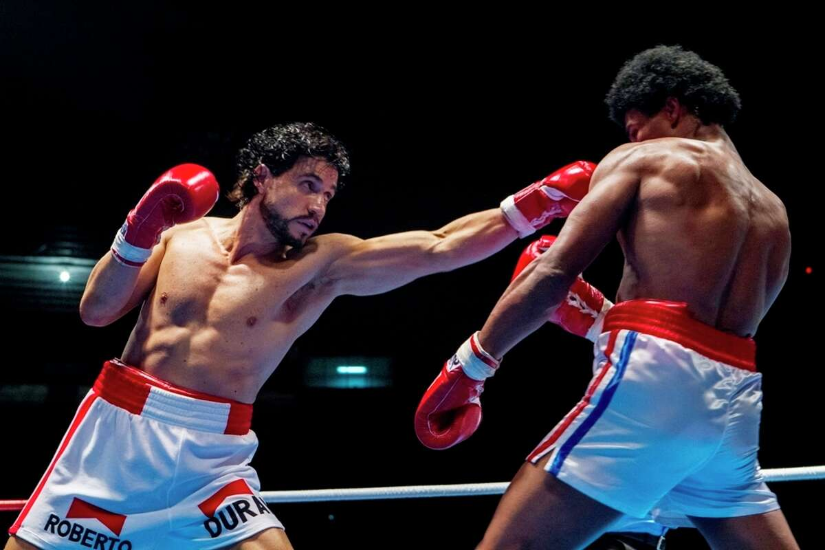 """This image released by The Weinstein Company shows Edgar Ramirez, left, and Usher Raymond in a scene from, """"Hands of Stone."""" (Rico Torres/The Weinstein Company via AP)"""