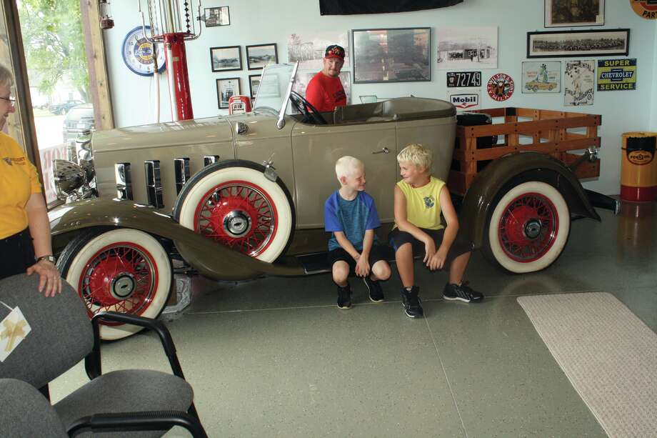 Brothers Keagun and Caeden Potestivo of Harbor Beach are some of the many visitors at the weekend's ABC Days in Port Hope. The brothers were able to sit on this customized 1932 Chevy Roadster as their parents toured the Gaslight Garage which was started in 1925 by the Kriewal family.