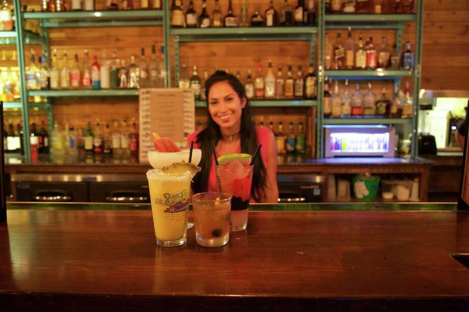 Krysta Quintanilla works the bar at The Well.