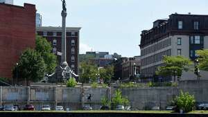 Troy's Monument Square and the former city hall site are viewed from the Hudson River on Friday, Aug. 5, 2016, in Troy, N.Y. (Will Waldron/Times Union)