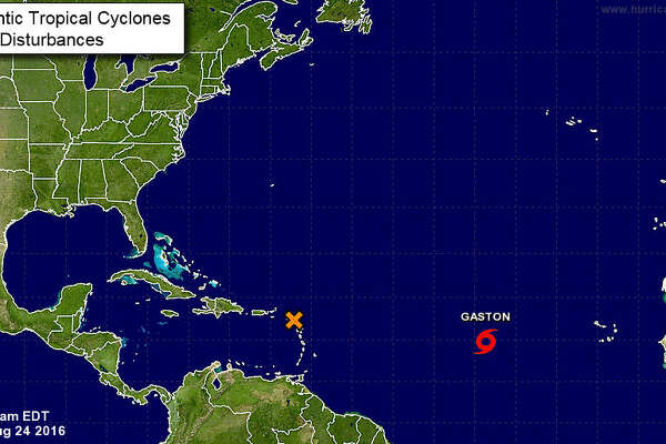 Forecasters are keeping a wary eye Wednesday on a disturbance in the Caribbean Sea as well a tropical storm in the Atlantic that could strengthen into a hurricane later in the day.(National Hurricane Center)