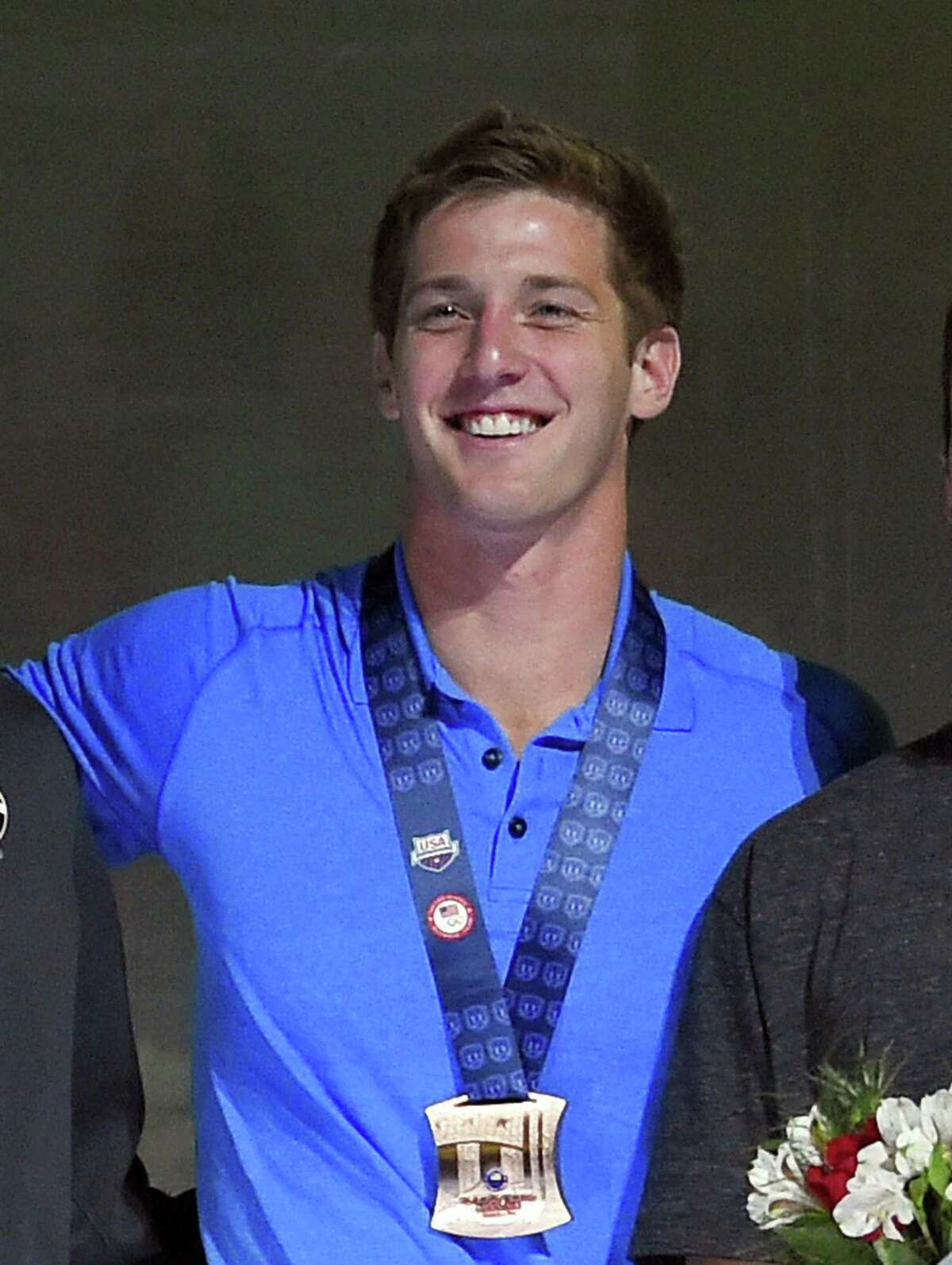 Former Churchill and UT standout Jimmy Feigen smiles during the men's 400-meter relay team medal ceremony at the U.S. Olympic Swimming Trials, in Omaha, Neb., on July 3, 2016.