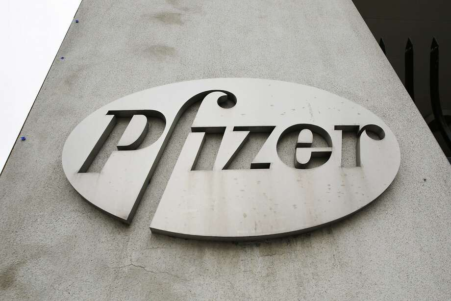 In this May 4, 2014 photo, the Pfizer logo is displayed on the exterior of a former Pfizer factory  in the Brooklyn borough of New York. (AP Photo/Mark Lennihan, File) Photo: Mark Lennihan, Associated Press