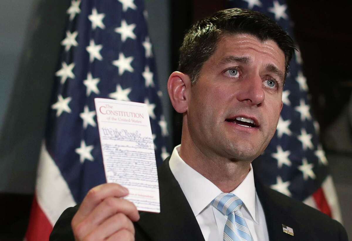 WASHINGTON, DC - JULY 06: U.S. Speaker of the House Rep. Paul Ryan (R-WI) holds up a copy of the U.S. Constitution during a press briefing after a House Republican Conference meeting July 6, 2016 at the headquarters of Republican National Committee in Washington, DC. (Photo by Alex Wong/Getty Images)