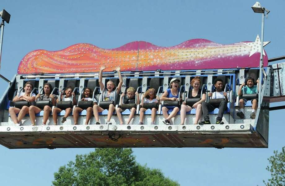 Fair goers enjoy a ride at the Columbia County Fair on Monday, Sept. 7, 2015 in Chatham, N.Y.  (Lori Van Buren / Times Union) Photo: Lori Van Buren / 10032907A