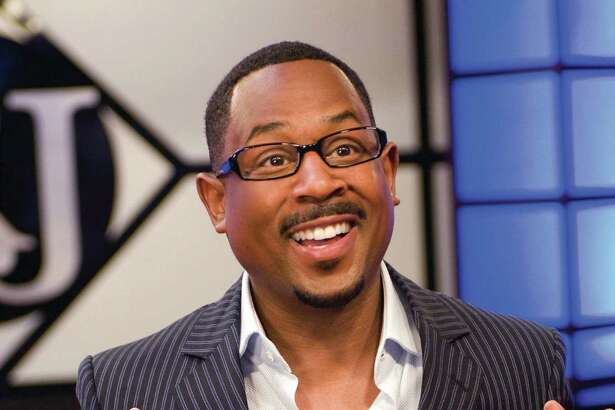"""In this image provided by Universal Studios, Martin Lawrence, portrays Dr. RJ  in a comedy about a self-help guru who returns home in """"Welcome Home Roscoe Jenkins"""". (AP Photo/Universal Studios, David Lee) ** NO SALES **"""