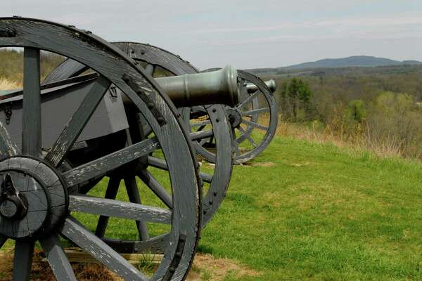 """This is the ninth stop on your tour of the site of the Saratoga National Historical Park, at the Saratoga Battlefield, which is known as the """"Turning Point of the American Revolution"""", on Thursday, April 30, 2009, in Stillwater, NY.  These are two cannons at the Great Redoubt, which was a system of fortifications built by the British on this hill, designed to guard their hospital, artillery park, Indian camp, and supplies, and the boat bridge across the Hudson River.  Gen. Burgoyne withdrew his army to this vicinity during the night of Oct. 7, 1777.  The site offers a 20 minute orientation film, a fiber-optic light map, timeline, and artifacts display and the self-guided loop around the battlefield, with interpretive stations on the way.  Nearby Schuyler House and the Saratoga Monument are also part of the park.      (Luanne M. Ferris / Times Union)"""
