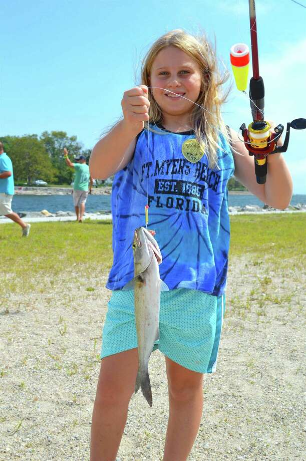 Adriana Holland, 9, of Fairfield proved to be one of the best fishers in town Saturday, Aug. 20 at South Benson Marina in Fairfield, Conn., during the annual P.A.L. Snapper Blue Tourney. Photo: Jarret Liotta / For Hearst Connecticut Media / Fairfield Citizen News Freelance