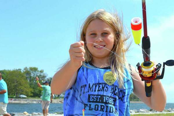Adriana Holland, 9, of Fairfield proved to be one of the best fishers in town Saturday, Aug. 20 at South Benson Marina in Fairfield, Conn., during the annual P.A.L. Snapper Blue Tourney.
