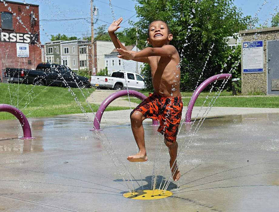 Schelra Smoot, 6, of Albany jumps threw the water at Sheridan Park spray pad on Wednesday, Aug. 24, 2016 in Albany, N.Y. (Lori Van Buren / Times Union) Photo: Lori Van Buren