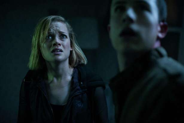 """This image released by Sony Pictures shows Jane Levy, left, and Dylan Minnette in a scene from """"Dont Breathe."""" (Gordon Timpen/Sony/Screen Gems via AP)"""