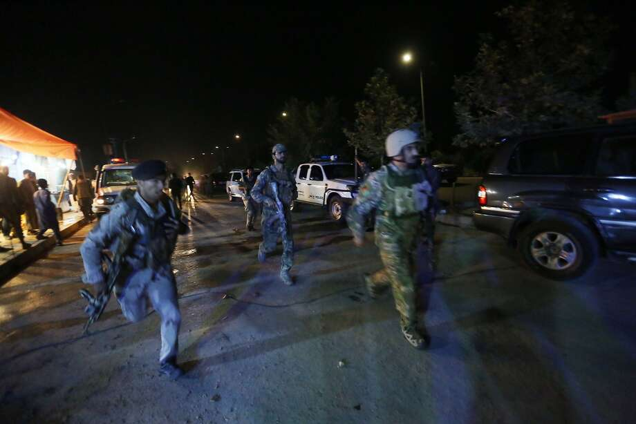 Security forces rush to respond to a Taliban attack on the campus of the American University in the capital, Kabul , Photo: Rahmat Gul, Associated Press