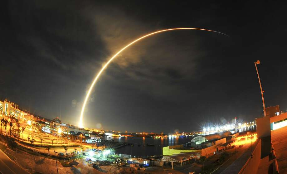 A SpaceX Falcon 9 rocket launches from Cape Canaveral this month. A similar rocket will loft a satellite commission ed by Facebook into space next month. Photo: Malcolm Denemark, Associated Press