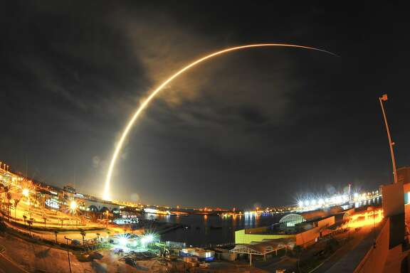 A SpaceX Falcon 9 rocket launches from Launch Complex 40 at Cape Canaveral Air Force Station in Florida, early Sunday, Aug. 14, 2016, with a Japanese communications satellite. (Malcolm Denemark/Florida Today via AP)