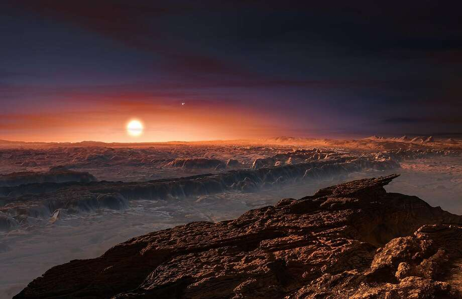This artist's impression shows a view of the surface of the planet Proxima b orbiting the red dwarf star Proxima Centauri, the closest star to the Solar System. Proxima b is a little more massive than the Earth and orbits in the habitable zone around Proxima Centauri, where the temperature is suitable for liquid water to exist on its surface. (M. Kornmesser/ESO) Photo: M. Kornmesser/ESO, TNS