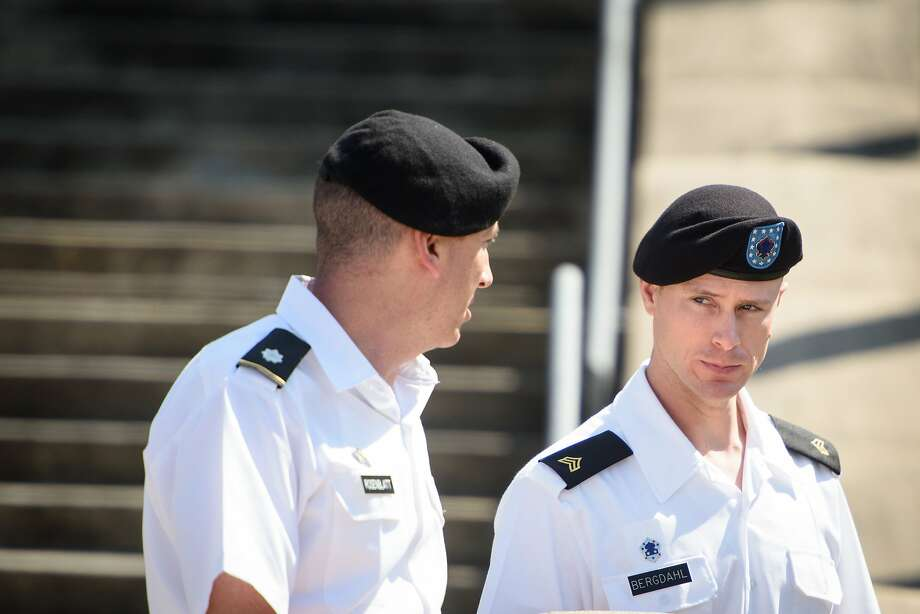 Sgt. Bowe Bergdahl (right) talks with his military attorney, Lt. Col. Franklin Rosenblatt, after a hearing at Fort Bragg, N.C. Photo: Andrew Craft, Associated Press
