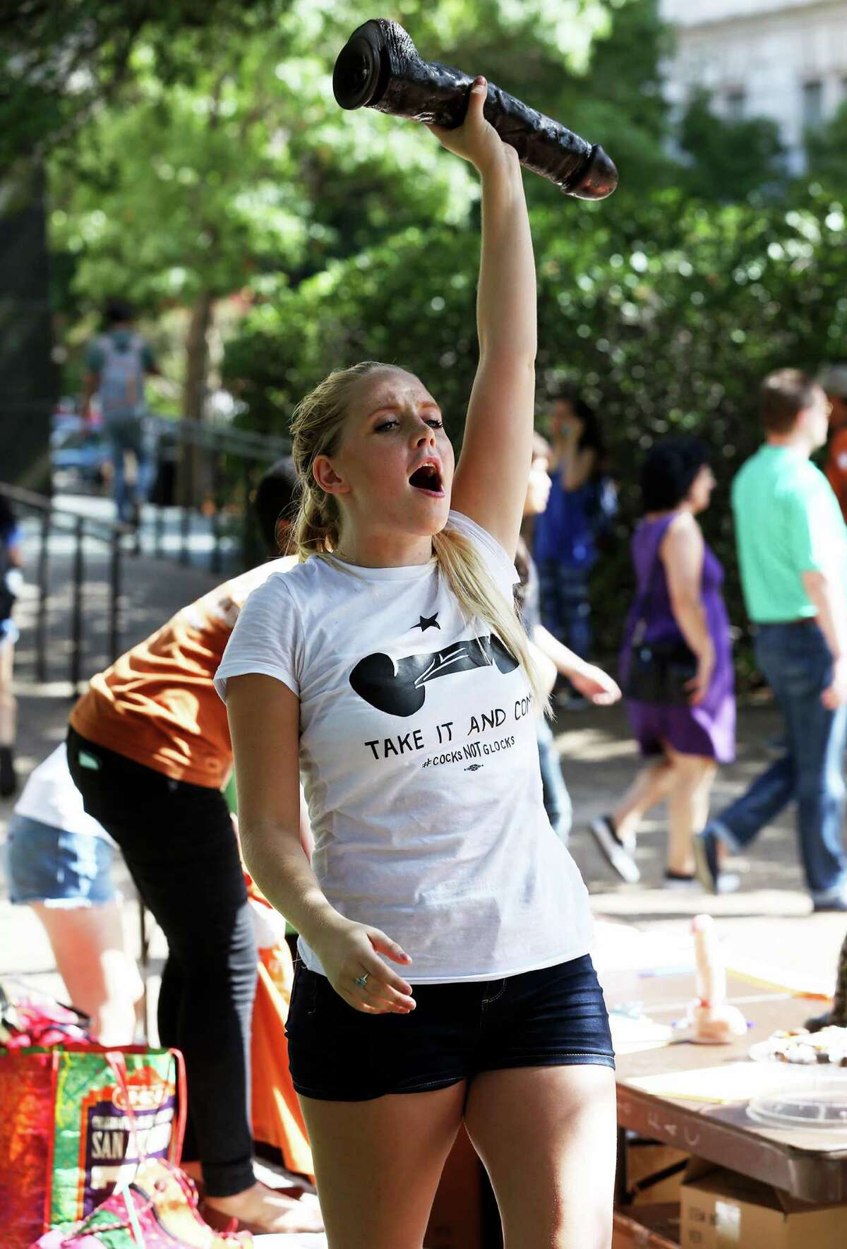 Rosie Zander shouts about a planned anti gun demonstration as students stage a protest against new campus carry rules for firearms on August 24, 2016