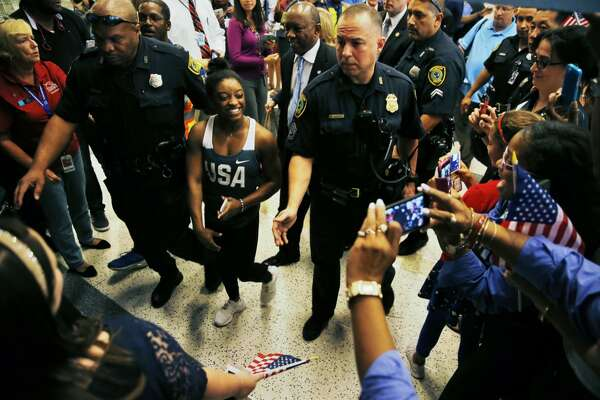 Gymnast Simone Biles is welcomed home at George Bush Intercontinental Airport after winning four gold medals and a bronze at the Olympics.