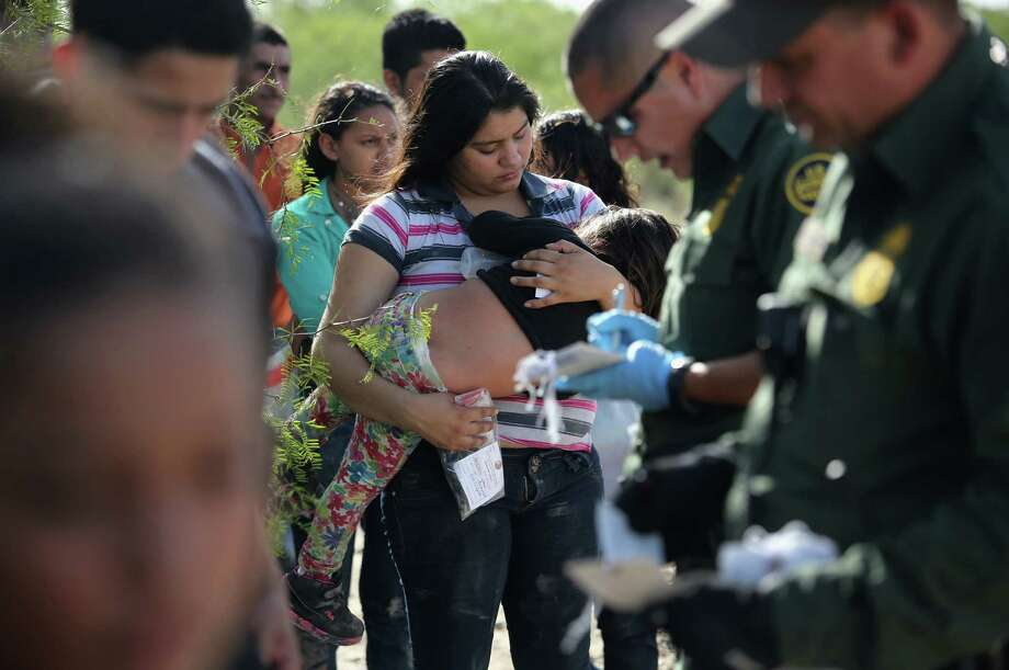 ROMA, TX - AUGUST 17:  U.S. Border Patrol agents process immigrants from Central America while taking them into custody on August 17, 2016 near Roma, Texas. Thousands of Central American families continue to cross the Rio Grande at the Texas-Mexico border, seeking asylum in the United States. Border security has become a major issue in the U.S. Presidential campaign.  (Photo by John Moore/Getty Images) Photo: John Moore, Staff / Getty Images / 2016 Getty Images