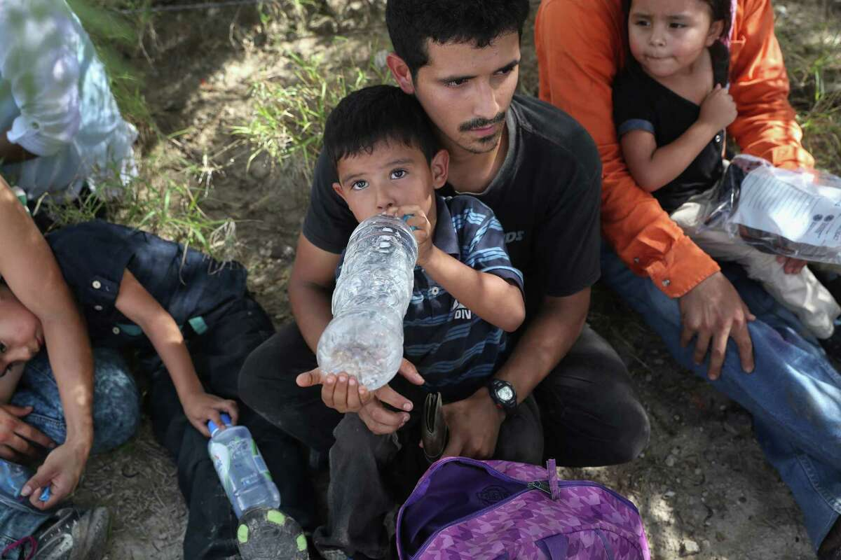 ROMA, TX - AUGUST 17: Immigrants from Central America drink water after being taken into custody by the U.S. Border Patrol on August 17, 2016 in Roma, Texas. Thousands of Central American families continue to cross the Rio Grande at the Texas-Mexico border, seeking asylum in the United States. Border security has become a major issue in the U.S. Presidential campaign. (Photo by John Moore/Getty Images)