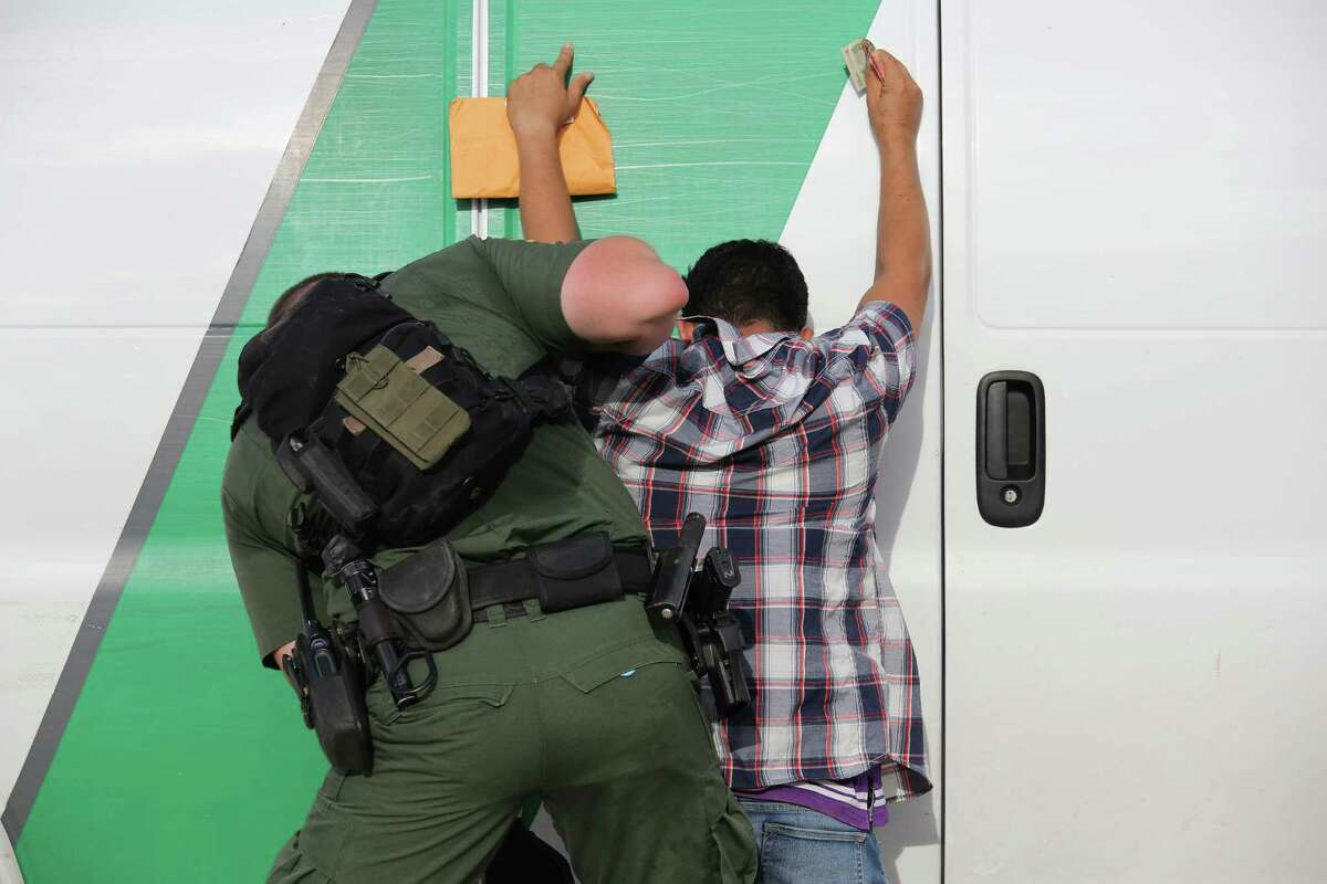 ROMA, TX - AUGUST 17: A U.S. Border Patrol agent searches an immigrant from Central America while taking him into custody on August 17, 2016 near Roma, Texas. Thousands of Central American families continue to cross the Rio Grande at the Texas-Mexico border, seeking asylum in the United States. Border security has become a major issue in the U.S. Presidential campaign. (Photo by John Moore/Getty Images)