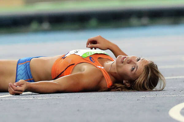 Dafne Schippers of the Netherlands looks on after falling in the finish area of the women's 200-meter final during the athletics competitions of the 2016 Summer Olympics at the Olympic stadium in Rio de Janeiro, Brazil, Wednesday, Aug. 17, 2016. (AP Photo/Lee Jin-man)