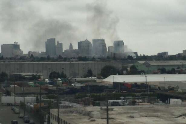 Smoke from a fire burning near downtown Oakland was seen Wednesday morning near Interstate 880.