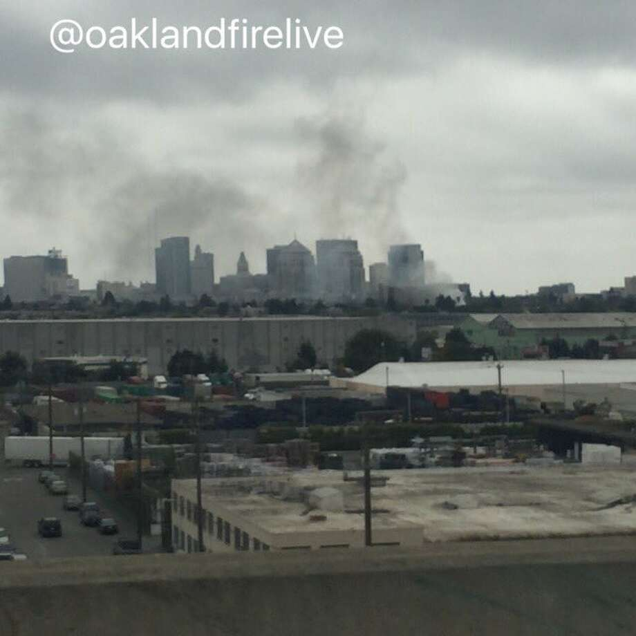 Smoke from a fire burning near downtown Oakland was seen Wednesday morning near Interstate 880. Photo: Oakland Firefighters (@oaklandfirelive) / /