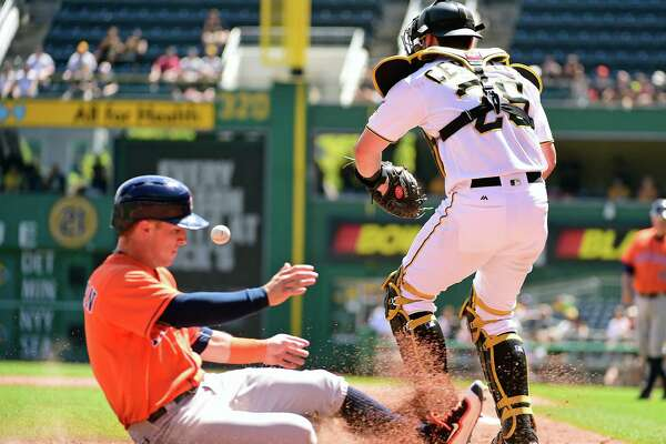 Houston Astros' Alex Bregman slides safely into home as Pittsburgh Pirates' Francisco Cervelli awaits a late throw in the fifth inning of a baseball game in Pittsburgh, Wednesday, Aug. 24, 2016. (AP Photo/Fred Vuich)