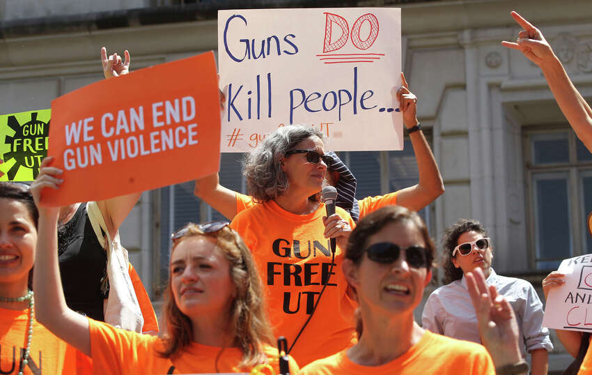 A group calling itself Gun Free UT protests the campus carry law on the steps of the main building (tower) on the University campus Wednesday August 24, 2016.