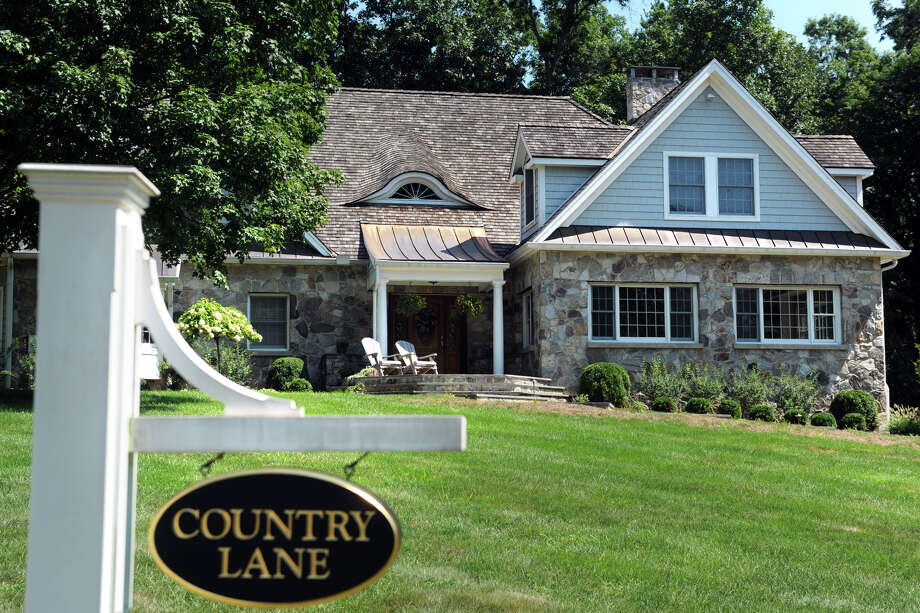 Grant was working on the house at 1 Country Lane in Westport. Photo: Ned Gerard / Hearst Connecticut Media / Connecticut Post