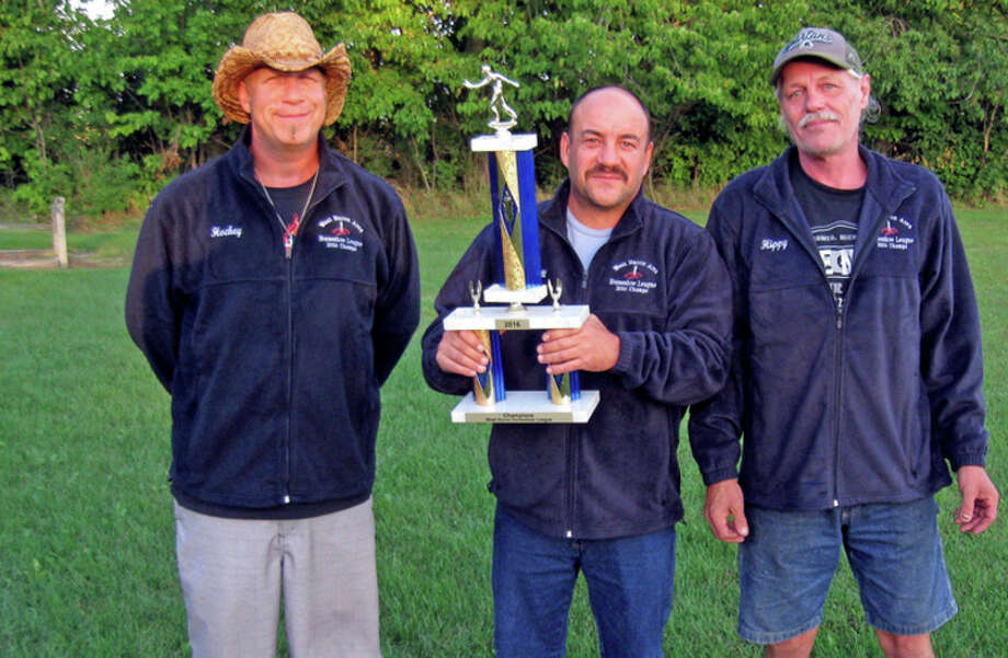 First-place winners -- Dufty's Blue Water Inn pictured (from left) John Rolando, Scott Kelly and Ernie Blackmor.