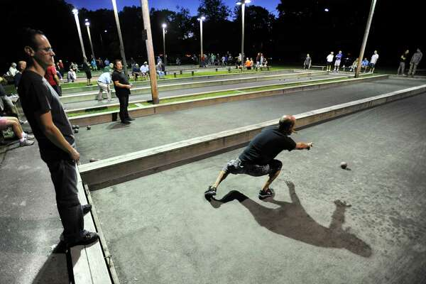 Charles Pia, of team Brickhouse, throws a ball during the last regular season game of the Stamford Bocce League season at Scalzi Park in Stamford, Conn. on Monday night, August 22, 2016.