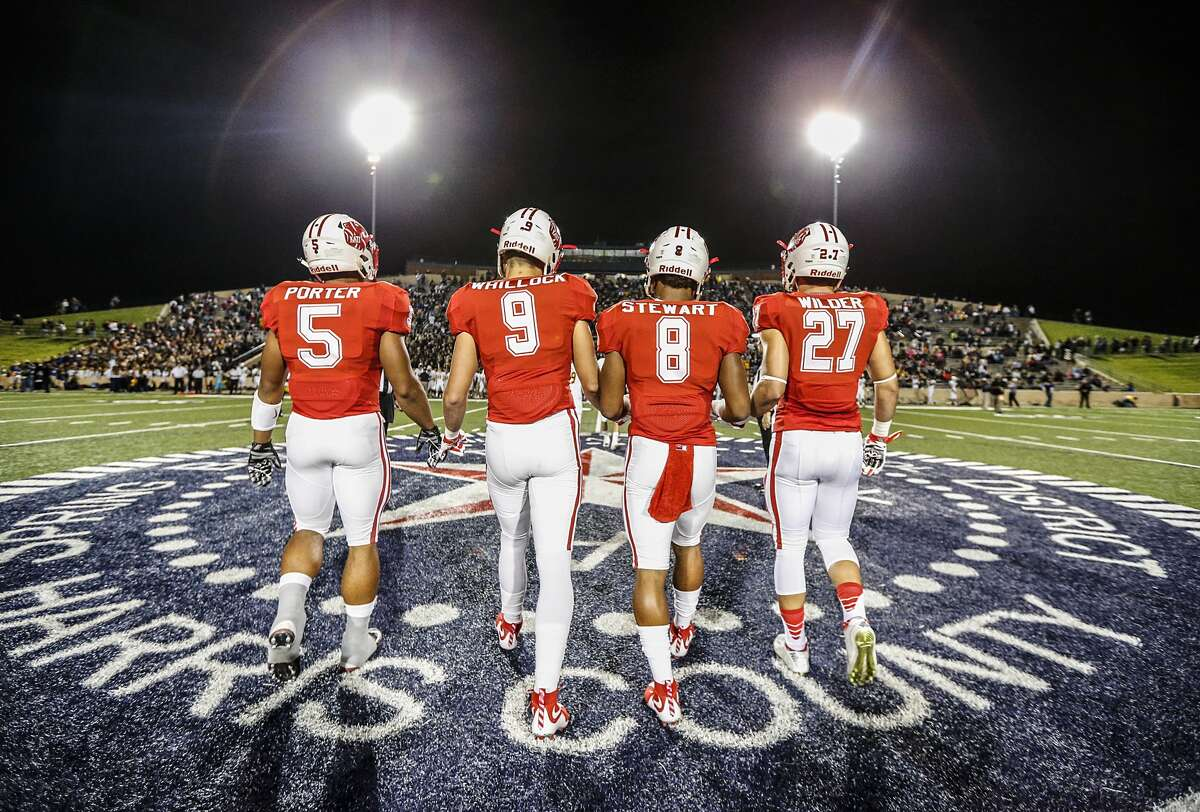 Katy Tigers' players walk out for the mid-field coin toss prior to a playoff game in 2015 versus Cinco Ranch High School.