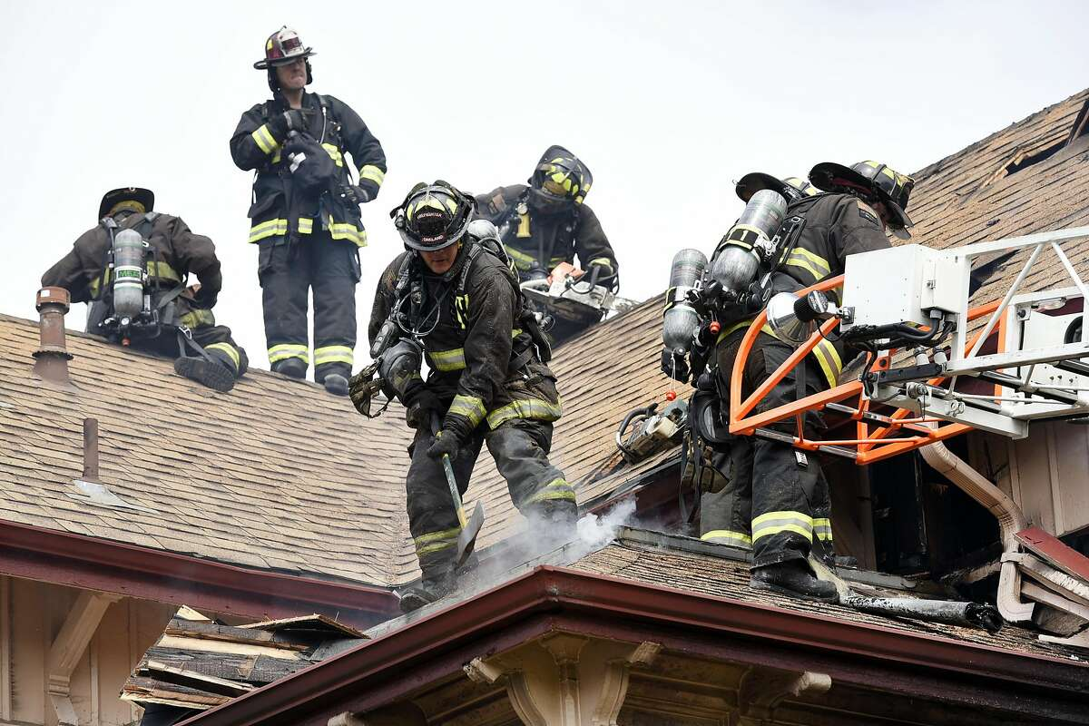 Members of the Oakland Fire Department work on extinguishing a fire in a duplex on Myrtle St. and 14th St. in Oakland, CA Wednesday, August 24, 2016.