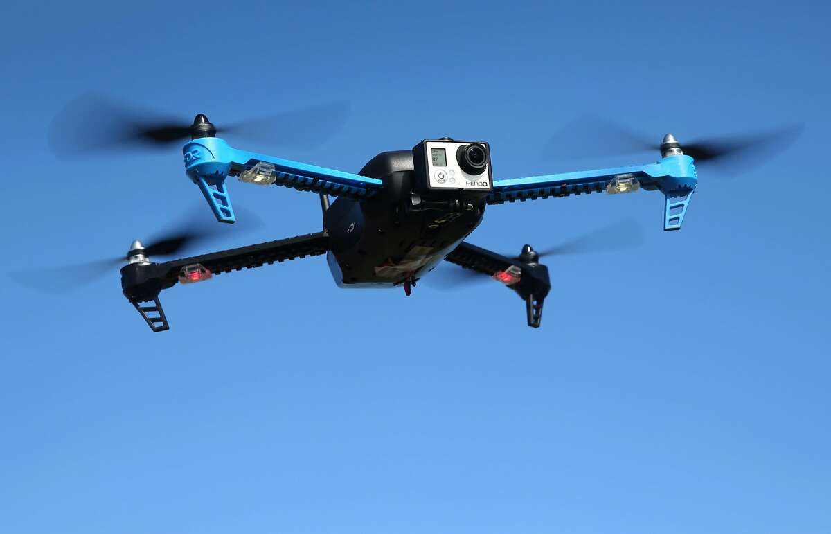 A drone with a camera mounted in front flies above Brisbane, Calif. on Friday, Feb. 27, 2015.