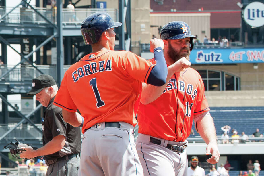 PITTSBURGH, PA - AUGUST 24: Evan Gattis #11 of the Houston Astros is greeted by Carlos Correa #1 after hitting a two run home run in the second inning during the game against the Pittsburgh Pirates at PNC Park on August 24, 2016 in Pittsburgh, Pennsylvania. (Photo by Justin Berl/Getty Images) Photo: Justin Berl, Stringer / 2016 Getty Images