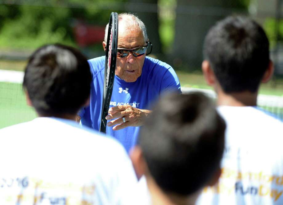 World-acclaimed tennis coach Nick Bollettieri works with participants at a tennis clinic at the courts at Cummings Park on Wednesday, Aug. 24, 2016 in Stamford. The Stamford Family Fun Day event, sponsored by Synchrony Foundation, the Stamford Youth Tennis Academy and the USTA Foundation, was attended by over100 Stamford youth and families, celebrating the efforts to support working families and their kids. Photo: Matthew Brown / Hearst Connecticut Media / Stamford Advocate