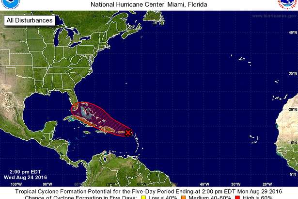 A still unorganized area of low pressure in a strong tropical wave between the northern Leeward Islands and Puerto Rico could develop quickly into a tropical depression or tropical storm in the next couple of days, the National Weather Service is reporting. (Photo: National Hurricane Center)