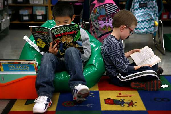 Sean Chaskin (left) and Jack Fahlgren read books in Joy Larkin's 3rd grade class at Serra Elementary School in San Francisco, Calif. on Wednesday, Aug. 24, 2016. A new literacy program has led to a dramatic improvement in test scores at Serra.