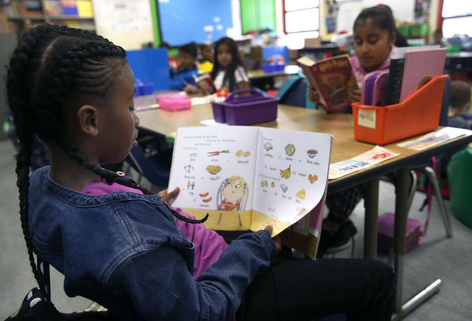 Yunique Sterling reads a book in Joy Larkin's 3rd grade class at Serra Elementary School in San Francisco, Calif. on Wednesday, Aug. 24, 2016. A new literacy program has led to a dramatic improvement in test scores at Serra. Photo: Paul Chinn, The Chronicle