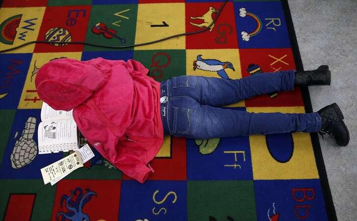 Jaslene Galdanez reads a book in Joy Larkin's 3rd grade class at Serra Elementary School in San Francisco, Calif. on Wednesday, Aug. 24, 2016. A new literacy program has led to a dramatic improvement in test scores at Serra.