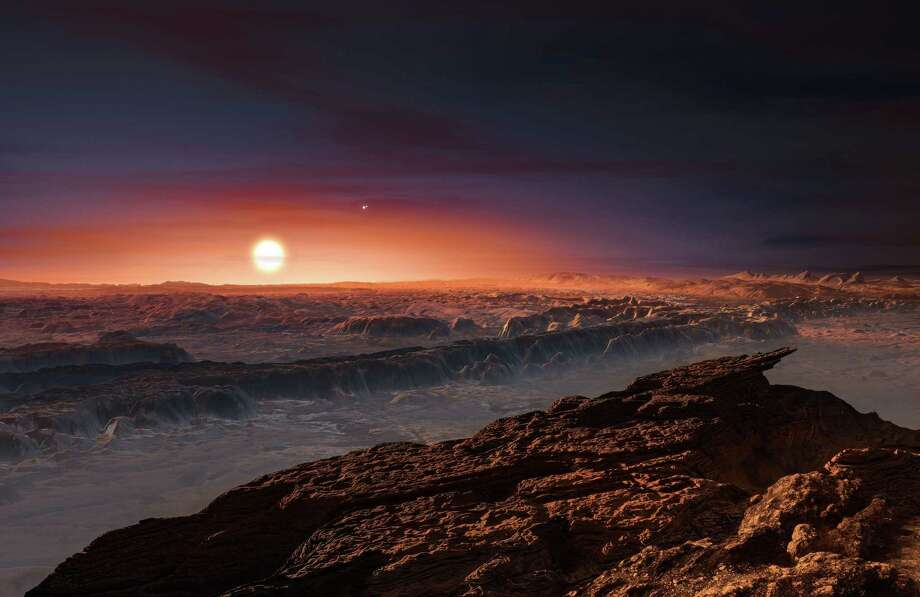 "A hand out image made available by the European Southern Observatory on August 24 2016, shows an artist's impression of a view of the surface of the planet Proxima b orbiting the red dwarf star Proxima Centauri, the closest star to the Solar System. The double star Alpha Centauri AB also appears in the image to the upper-right of Proxima itself. Proxima b is a little more massive than the Earth and orbits in the habitable zone around Proxima Centauri, where the temperature is suitable for liquid water to exist on its surface.  Scientists on August 24, 2016 announced the discovery of an Earth-sized planet orbiting the star nearest our Sun, opening up the glittering prospect of a habitable world that may one day be explored by robots. Named Proxima b, the planet is in a ""temperate"" zone compatible with the presence of liquid water -- a key ingredient for life.   / AFP PHOTO / EUROPEAN SOUTHERN OBSERVATORY / M. KornmesserM. KORNMESSER/AFP/Getty Images Photo: M. KORNMESSER, AFP/Getty Images / AFP"