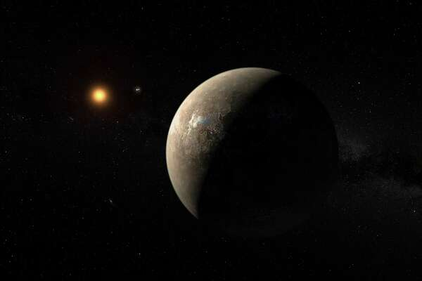 This artist's impression shows the planet Proxima b orbiting the red dwarf star Proxima Centauri, the closest star to the Solar System. Proxima b is a little more massive than the Earth and orbits in the habitable zone around Proxima Centauri, where the temperature is suitable for liquid water to exist on its surface. (M. Kornmesser/ESO)